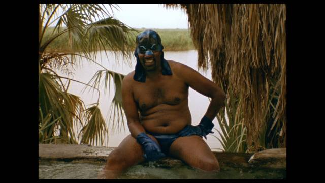 Batro (Solomon Tashe) relaxes as he plots against his enemies in Miguel Llanso's Jesus Shows You the Way to the Highway (2019)