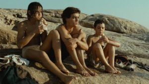 After escaping the reformatory, street kids relax by the sea in Hector Babenco's Pixote (1980)