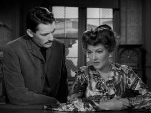 Old friend Molly (Jean Parker) tells Jimmy Ringo (Gregory Peck) where his wife and child are now living in Henry King's The Gunfighter (1950)