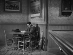 Jimmy Ringo (Gregory Peck) tries to blend into the background to avoid confrontations in Henry King's The Gunfighter (1950)