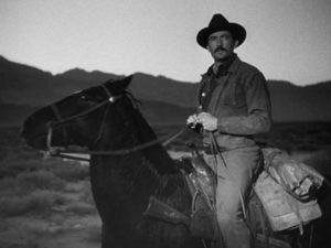 Weary, dressed in poorly fitting clothes, Jimmy Ringo (Gregory Peck) wants to leave his past behind in Henry King's The Gunfighter (1950)