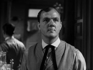 Saloon-keeper Mac (Karl Malden) sees potential profit in Jimmy Ringo (Gregory Peck)'s presence in Henry King's The Gunfighter (1950)