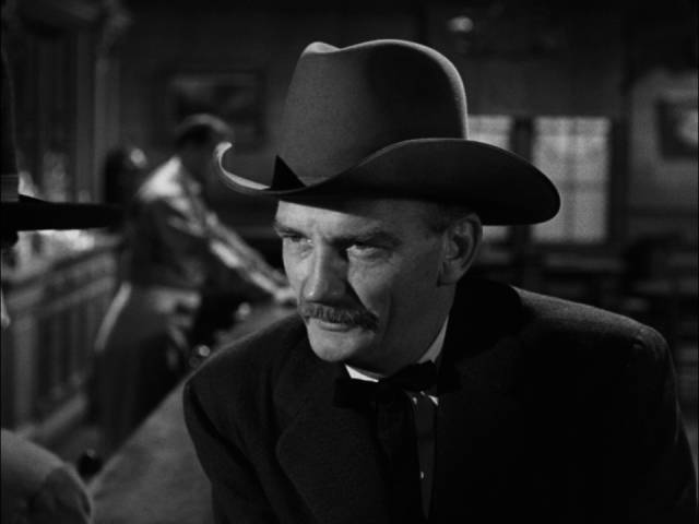 Old friend, now Marshal, Mark Strett (Millard Mitchell) wants Jimmy Ringo (Gregory Peck) to get out of town in Henry King's The Gunfighter (1950)