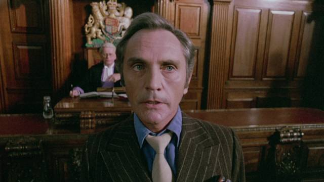 Willie Parker (Terence Stamp) testifies against his gang at the start of Stephen Frears' The Hit (1984)