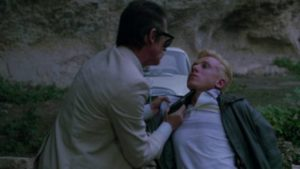 Willie Parker (Terence Stamp) sows seeds of conflict between hitman Braddock (John Hurt) and his protege Myron (Tim Roth) in Stephen Freears' The Hit (1984)