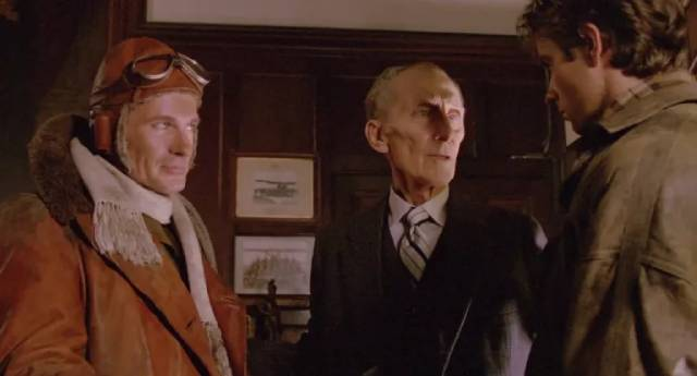 The Commodore (peter Cushing) explains a vital mission to Biggles (Neil Dickson) and Jim Ferguson (Alex Hyde-White) in John Hough's Biggles (1986)