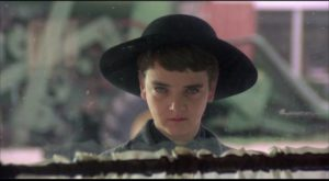 Diminutive cult leader Isaac (John Franklin) leads the slaughter of adults in Fritz Kiersch's Children of the Corn (1984)