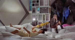 Diabolik (John Phillip Law) and Eva Kant (Marissa Mell) relax between crimes in Mario Bava's Danger: Diabolik (1968)