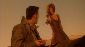 Wendy (Chelsea Field) doesn't want to give her life to the demon (Robert Burke) in Richard Stanley's Dust Devil (1992)