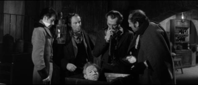 Dr. Knox (Peter Cushing) examines Burke & Hare's latest delivery in John Gilling's The Flesh and the Fiends (1960)