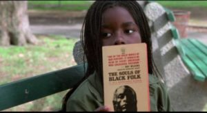 Pearline (Camille Winbush) talks books with Ghost Dog (Forest Whitaker) in the park in Jim Jarmusch's Ghost Dog: The Way of the Samurai (1999)