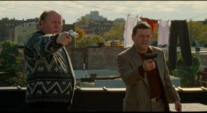 Ageing gangsters, irritated by their climb, are ready to shoot anybody they find on the roof in Jim Jarmusch's Ghost Dog: The Way of the Samurai (1999)