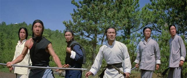 A young Jackie Chan (l) plays it straight in John Woo's The Hand of Death (1976)