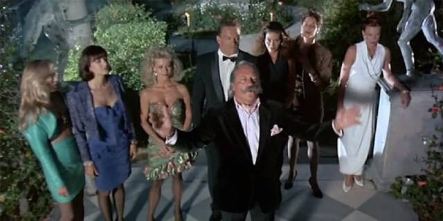Dictator Bartos (Oliver Reed) takes an interest in haute couture in Nico Mastorakis' Hired to Kill (1989)