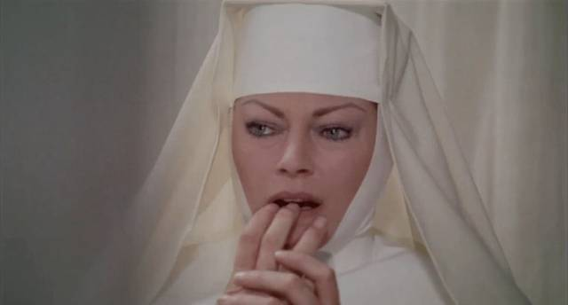 Sister Gertrude (Anita Ekberg) has doubts about her own sanity in Giullio Berruti's Killer Nun (1979)