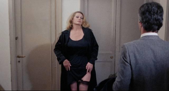 Sister Gertrude (Anita Ekberg) picks up men for sordid quickies in Giullio Berruti's Killer Nun (1979)