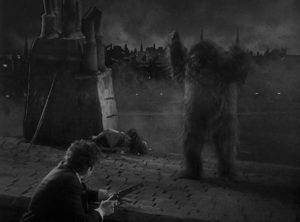 Pierre Dupin (Leon Ames) rescues Camille (Sidney Fox) from Erik on a Paris rooftop in Robert Florey's Murders in the Rue Morgue (1932)