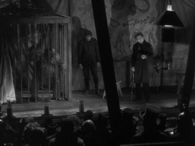 Dr. Mirakle (Bela Lugosi) exhibits the ape Erik in a seedy sideshow in Robert Florey's Murders in the Rue Morgue (1932)