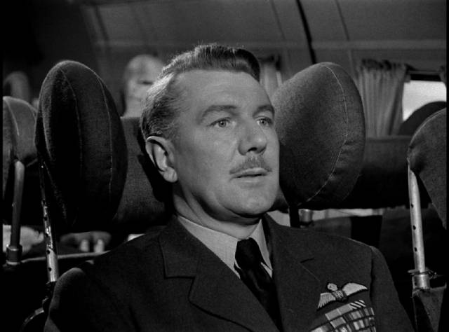 Air Marshal Hardie (Michael Redgrave) contemplates fate on a troubled flight in Leslie Norman's The Night My Number Came Up (1955)