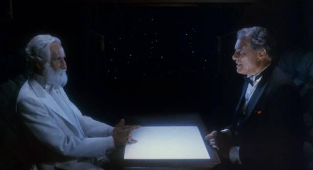 God (Ferdy Mayne) and the Devil (Tony Giorgio) gamble for souls in Night Train to Terror (1985)