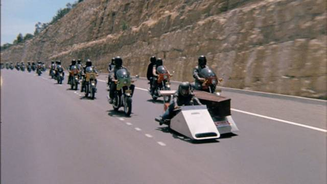 A biker gang holds a funeral for a murdered member in Sandy Harbutt's Stone (1974)