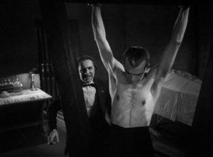 Dr. Vitus Werdegast (Bela Lugosi) exacts a painful revenge by skinning Hjalmar Poelzig (Boris Karloff) alive in Edgar G. Ulmer's The Black Cat (1934)