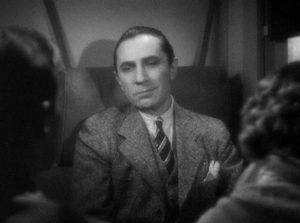 The melancholy Dr. Vitus Werdegast (Bela Lugosi) recounts his sad story to fellow travellers in Edgar G, Ulmer's The Black Cat (1934)