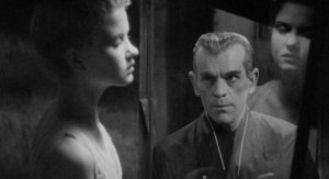 Hjalmar Poelzig (Boris Karloff) and the preserved body of the woman he loved in Edgar G. Ulmer's The Black Cat (1934)