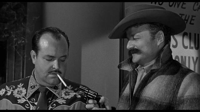 Brick (Brian Keith) pulls a gun on casino security man Eric Berg (William Conrad) in Phil Karlson's 5 Against the House (1955)