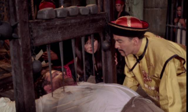Fu Manchu (Christopher Lee) enjoys a torture break in Jess Franco's The Blood of Fu Manchu (1968)