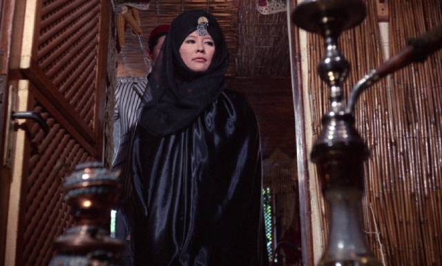 Lin Tang (Tsai Chin) supports her father's evil schemes without reservation in Jess Franco's The Castle of Fu Manchu (1969)