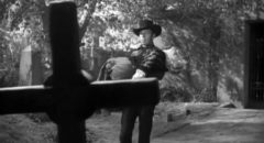 Gunslinger Drake Robey (Michael Pate) is at home in the graveyard in Edward Dein's Curse of the Undead (1959)
