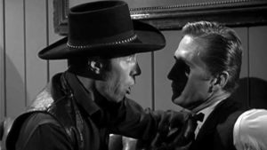 Preacher Dan (Eric Fleming) knows Drake Robey (Michael Pate) is no ordinary man in Edward Dein's Curse of the Undead (1959)