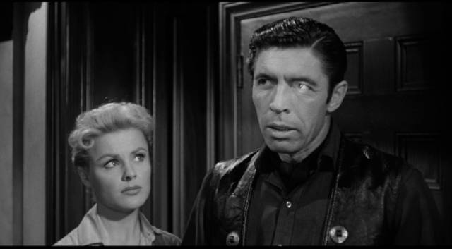 Dolores (Kathleen Crowley) hires gunslinger Drake Robey (Michael Pate) to protect her land in Edward Dein's Curse of the Undead (1959)