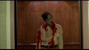 Stephen (David Emgee) succumbs to misplaced priorities in George A. Romero's Dawn of the Dead (1978)