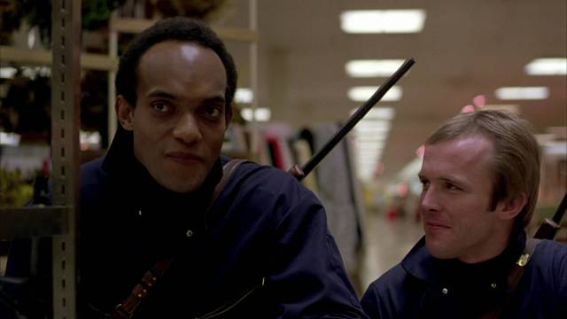 Peter (Ken Foree) and Roger (Scott H. Reiniger) realize what they have in a Mall of their own in George A. Romero's Dawn of the Dead (1978)