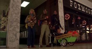Fran (Gaylen Ross), Stephen (David Emgee), Peter (Ken Foree) and Roger (Scott H. Reiniger) claim the consumer paradise for themselves in George A. Romero's Dawn of the Dead (1978)