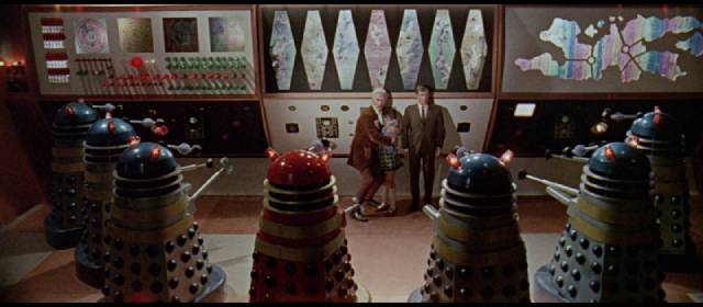 The Doctor (Peter Cushing) and his companions are cornered by the evil Daleks in Gordon Flemyng's Dr. Who and the Daleks (1965)