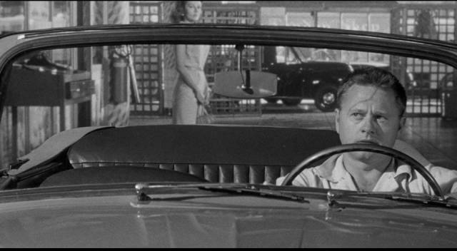 Eddie Shannon (Mickey Rooney) wonders what Barbara Mathews (Dianne Foster) is after in Richard Quine's Drive a Crooked Road (1954)