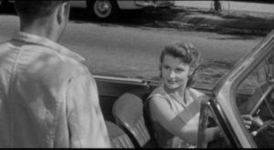 Barbara Mathews (Dianne Foster) seems to be pursuing Eddie Shannon (Mickey Rooney) in Richard Quine's Drive a Crooked Road (1954)