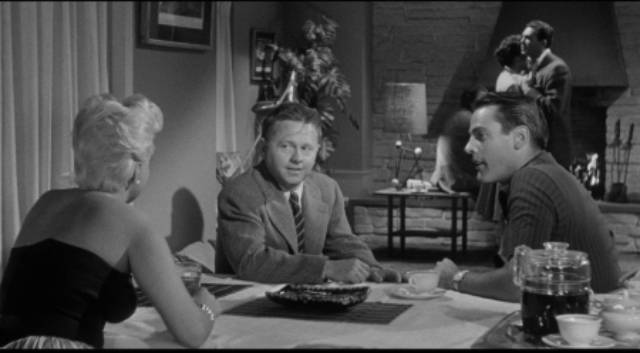Steve Norris (Kevin McCarthy) offers Eddie Shannon (Mickey Rooney) some easy money in Richard Quine's Drive a Crooked Road (1954)
