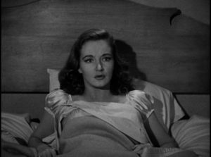Eileen Carr (Nina Foch) wakes from a nightmare in Budd Boetticher's Escape in the Fog (945)