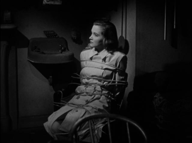 Eileen Carr (Nina Foch) finds herself in a really bad spot in Budd Boetticher's Escape in the Fog (1945)