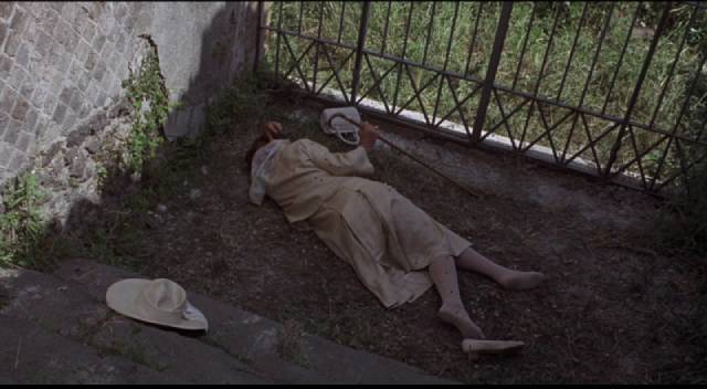 Tim Brett (David Hemmings)'s new acquaintance Lucy Dawson (Flora Robson) is found dead in the ruins of Pompeii
