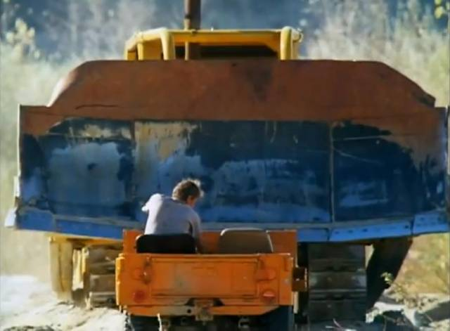 The oilmen need to use ingenuity against the 'dozer's brute force in Jerry London's Killdozer (1974)