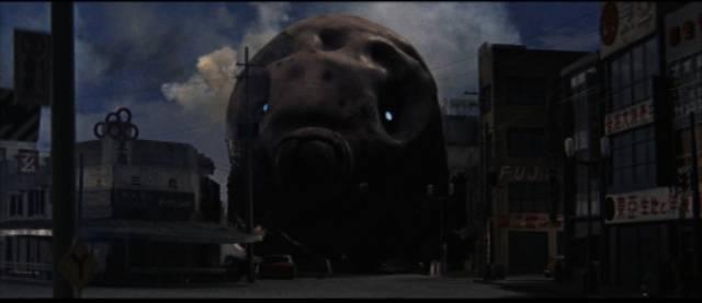 The giant larva arrives in Tokyo in Ishiro Honda's Mothra (1961)