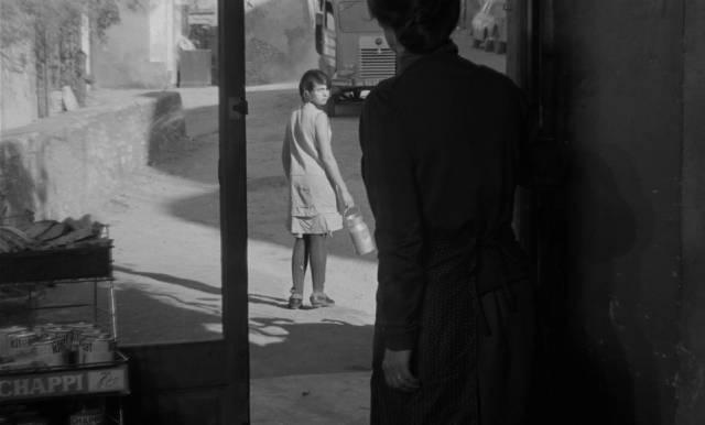 Mouchette rejects her neighbours' judgmental gaze in Robert Bresson's Mouchette (1967)