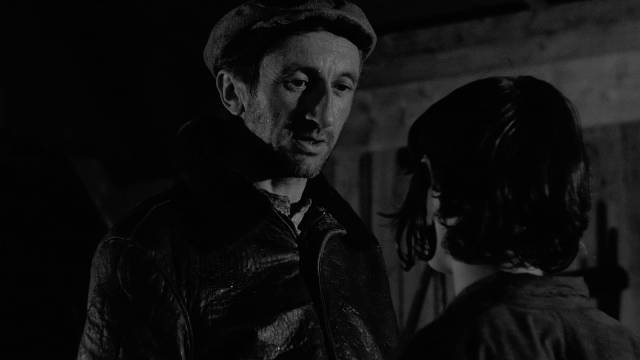 The poacher Arsene (Jean-Claude Guilbert) embodies an adult mystery in Robert Bresson's Mouchette (1967) ...