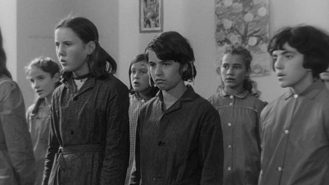 Mouchette (Nadine Nortier) doesn't fit in at school and is openly resentful in class in Robert Bresson's Mouchette (1967)