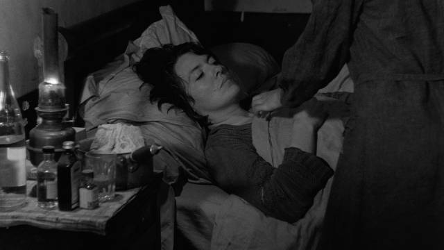 Mouchette (Nadine Nortier) presides alone over her mother's painful death in Robert Bresson's Mouchette (1967)
